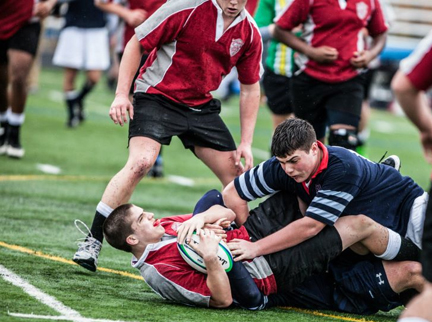 Lincoln's Jack Bigelow (dark shirt) fights for the ball during a recent rugby match.