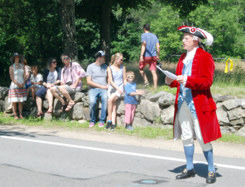Lincoln historian and Minute Man Richard Wiggin reads the Declaration of Independence before the parade.